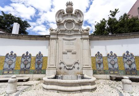 Chafariz da Cordoaria, also know as Chafariz da Junqueira, built in early 19th century with lioz stone and traditional decorative tile panels, in Lisbon, Portugal