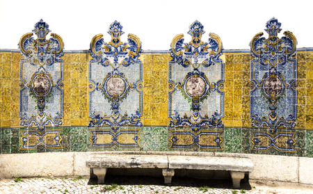 Traditional polychromatic decorative tiles with birds on the central medallion on both sides of the Chafariz da Cordoaria in Lisbon, Portugal Stock Photo