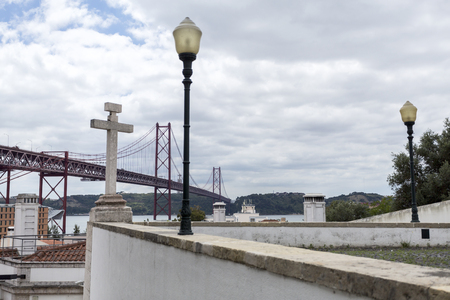 View of the 25th of April suspension bridge crossing the Tagus River seen from the belvedere of Saint Amaro in Lisbon, Portugal Stock Photo