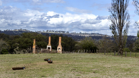 Ruins of three chimneys and fire places reminders of a glorious bygone era in the rural countryside of New England, in New South Wales, Australia