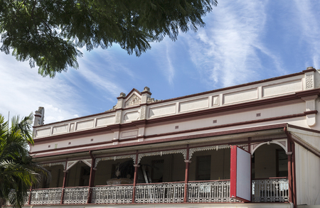 View of the balcony with a wrought iron balustrade of the W.J. Weilev heritage building, in the country town of Grafton, New South Wales, Australia