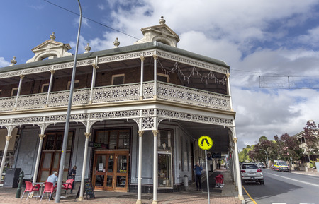 Facade of the heritage listed Imperial Hotel built in 1889 and ornamented with cast-iron friezework, bullnose awnings and parapets with Grecian urns and pediments on arches, in Armidale, NSW, Australia