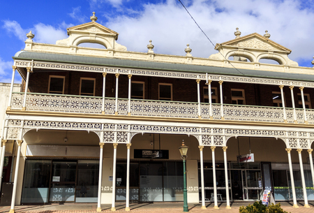 Detail of the heritage listed Imperial Hotel built in 1889 and ornamented with cast-iron friezework,  bullnose awnings and parapets with Grecian urns and pediments on arches, in Armidale, NSW, Australia