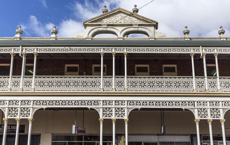 Detail of the heritage listed hotel built in 1889 and ornamented with cast-iron friezework, bullnose awnings and parapets with Grecian urns and pediments on arches, in Armidale, NSW, Australia Editorial