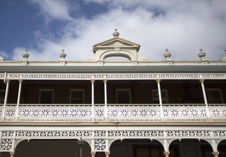 Detail of the heritage listed Hotel built in 1889 and ornamented with cast-iron friezework, bullnose awnings and parapets with Grecian urns and pediments on arches, in Armidale, NSW, Australia