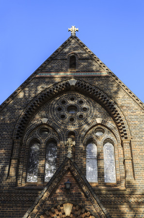 Detail of the central window of Anglican Cathedral of St Peter Apostle and Martyr, built from brick and completed in 1875 in Gothic architectural style, in Armidale, NSW, Australia
