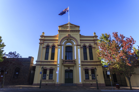 View of the ostentatious Town Hall, a two-storey High Victorian building completed in 1882 with a stuccoed brick facade including pilasters, scrolls, frieze and pediment, in Armidale, NSW, Australia