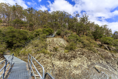 View of the metal stairway of the walking track along the panoramic Wollomombi Gorege, a wild river in New England National Park, Northern New South Wales, Australia Imagens