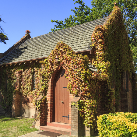 Detail of the lateral facade of the Gostwyck Chapel, known as All Saints Anglican Church, built in 1921 near Uralla, NSW, Australia