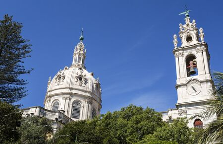 Dome and clock tower of the late Baroque and Neo-Classical Royal Basilica and Convent of the Most Sacred Heart of Jesus, built in late 18th century in Lisbon, Portugal