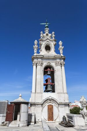 Detail of the clock tower of the late Baroque and Neo-Classical Royal Basilica and Convent of the Most Sacred Heart of Jesus, built in late 18th century in Lisbon, Portugal