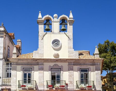 View of the double bell clock tower in the municipality centre of the charming coastal town of Cascais, Portugal