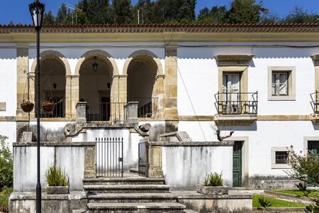 Facade of the former Priests House located in the front garden of the Monastery of Saint Mary of Lorvao, Coimbra, Portugal