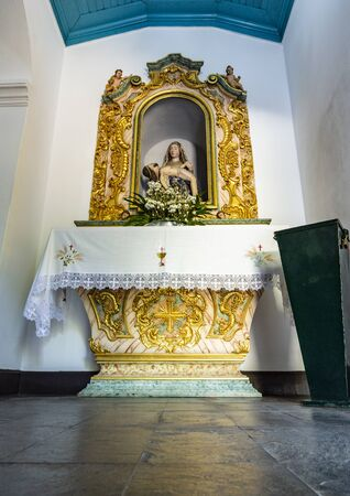 Altar dedicated to Our Lady of Pity in the sacristy of the Chapel of St John, in the Sanctuary of Our Lady of Pity, next to the Castle of Lousa, Coimbra, Portugal Archivio Fotografico