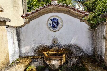 Water fountain in Candal, a schist village nestled in the Lousa Mountain Range, Coimbra, Portugal Foto de archivo