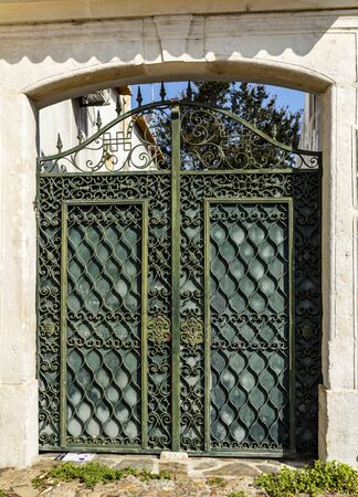 Detail of the wrought iron gate of an old farm in the town of Tentugal, Coimbra, Portugal