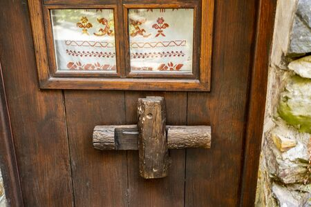 Traditional door lock made of timber in the old schist village of Talasnal, where nature reigns in the Lousa Mountain Range, Coimbra, Portugal Stock Photo