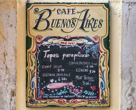 View of the tapas menu on the external wall of the Cafe Buenos Aires in the Baixa-Chiado area of the old city of Lisbon, Portugal