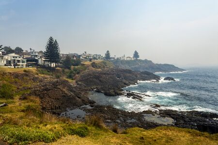 View of the basalt foreshore line, seen from the lookout platform by the Little Blowhole at Tingira Crescent, Kiama, Southern Coast, NSW, New South Wales, Australia