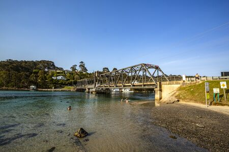 View from the south east of the road bridge over the Wagonga Inlet, completed in 1931 in Narooma, South Coast of New South Wales, Australia Stock Photo