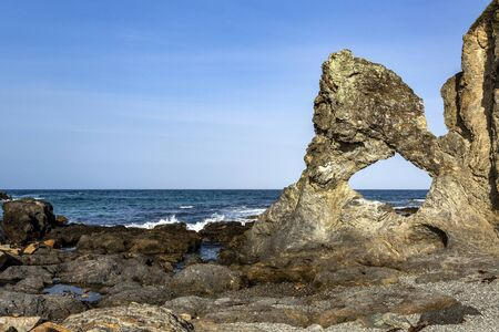 View of the hole in the rock at Wagonga Head, with its remarkable resemblance to a map of Australia, in Narooma, South Coast of New South Wales, Australia