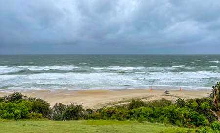 Magnificent beach under the Surf Life Saving surveillance during a very windy and rainy day, in the Sunshine Coast, Queensland, Australia