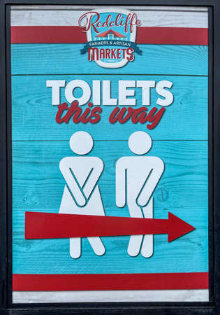 Sign indicating the way to the nearst local public toilets