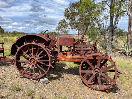 Old rusty agricultural tractor equipment in the field of a farm in Queensland, Australia Reklamní fotografie