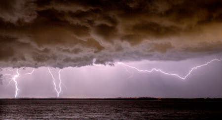 Two common types of lightning: cloud to ground and cloud to air Stock Photo