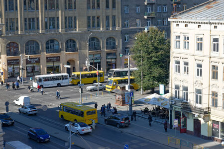 LVIV, UKRAINE - OCTOBER 4, 2014: View of busy street with buses and pedestrians on 4 October 2014, Lviv, Ukraine.