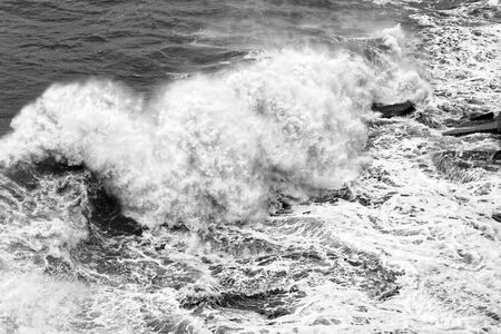 Black and white crashing waves at the sea in storm