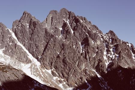 Retro shot of mountain peaks in High Tatras in Velka Studena dolyna