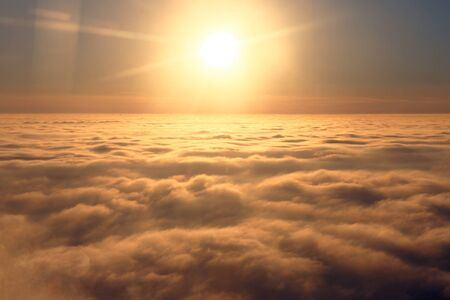 Panoramic view of sky above clouds from the window of plane Reklamní fotografie