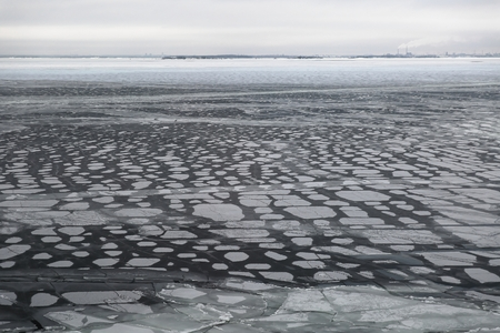 Floating snowy cracked ice flow in the Baltic sea forming a texture with pattern Reklamní fotografie