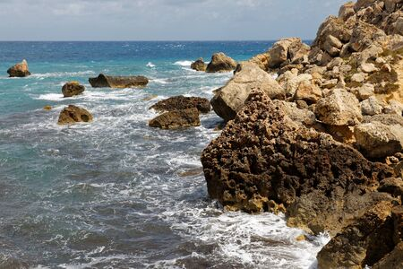 Rocky seashore of the island Gozo in Malta in the middle of mediterranean sea with vivid colors of stones and water