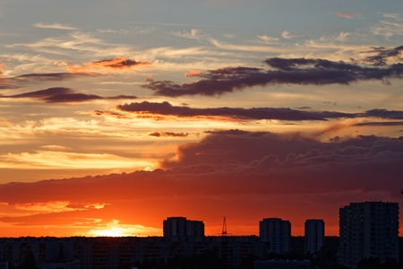 Sunset with gradient colors and epic clouds in Tallinn with contrast building silhouettes