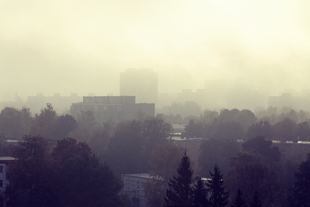 Landscape of the city in the morning with fog creating air perspective of the silhouettes of building and trees