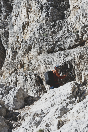 Climber ascending the via ferrata in the Dolomites Stock fotó