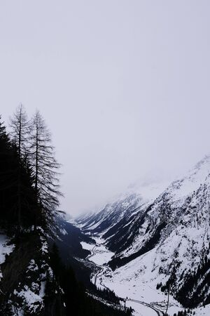 Misty mountain ranges in Pitztal valley with snow covered landscapes
