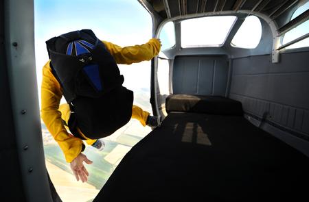 Parachuting on sunny day Stock Photo