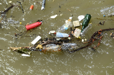 Polluted river with garbage