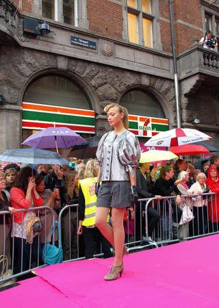 longest: COPENHAGEN - AUGUST 14 : Participating model at the longest ever catwalk during the Copenhagen Fashion Week. 220 models joins the mile long catwalk on August 14, 2010 in Copenhagen, Denmark.