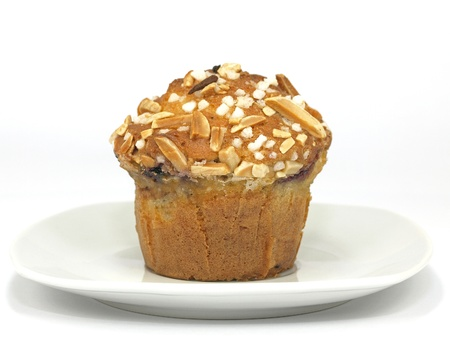blueberry muffin: blueberry muffin with almond toppings on plate