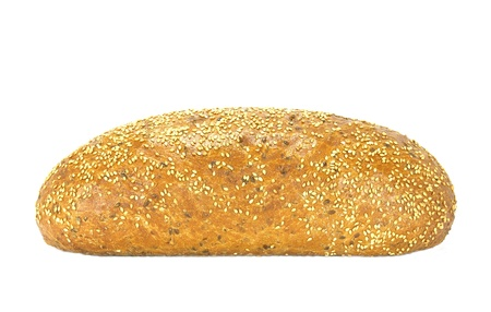 unsliced: isolated loaf of baked bread with sesame seeds