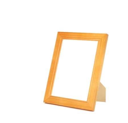 isolated varnished wooden picture frame with stand photo
