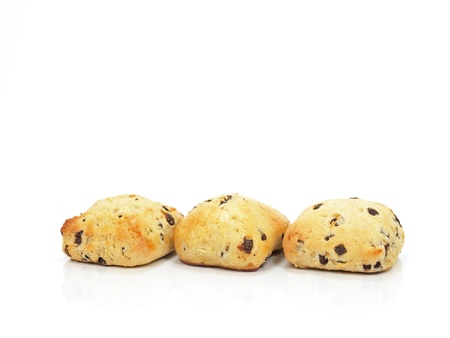 spongy: three spongy chocolate chip scones on white background Stock Photo