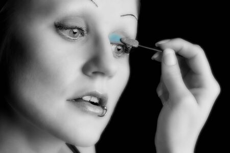 closeup of model applying makeup