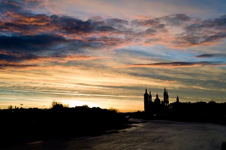 zaragoza: Sunset at the river Ebro, in Zaragoza (Saragossa), Spain. Basilica of Our Lady of the Pillar.