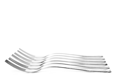 composition: High-key composition with forks