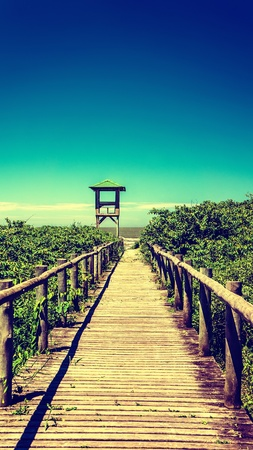 getting away from it all: Wooden pathway leading to beautiful tropical beach